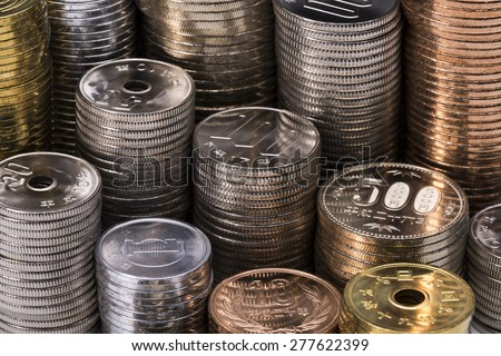 Stacked Japanese coins - stock photo