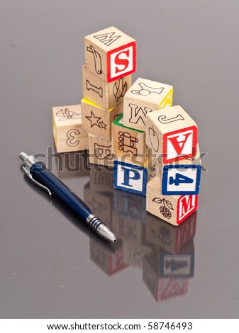 Stacked Learning Blocks with Pen - stock photo