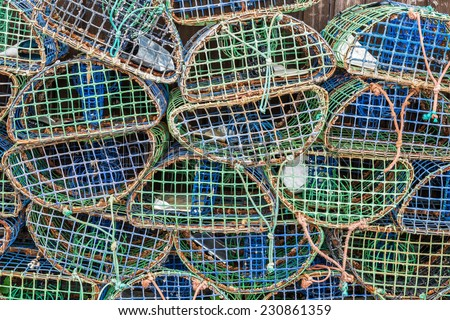 Stacked lobster and crab  traps in the port of Santa Luzia, Algarve, Portugal, Europe - stock photo