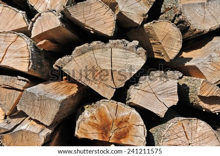 Stacked log background from natural tree timber - stock photo