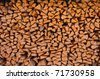 stacked logs of fire wood - stock photo