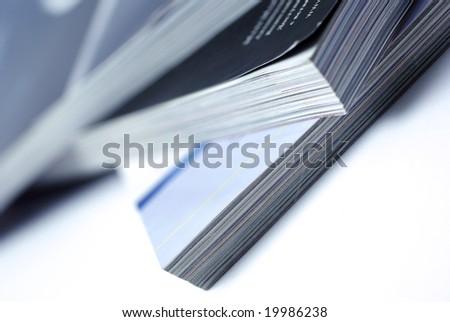 Stacked magazines isolated on white background. - stock photo