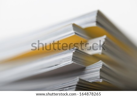 Stacked magazines up close - stock photo