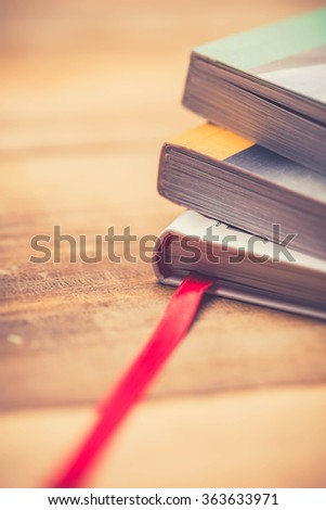 Stacked magazines up close - stock photo