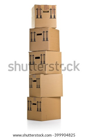 Stacked moving carton boxes over white background - stock photo