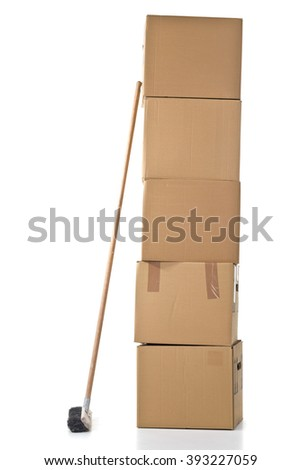 Stacked moving carton boxes with broom over white background - stock photo
