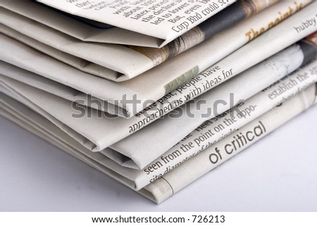Stacked newspaper - stock photo