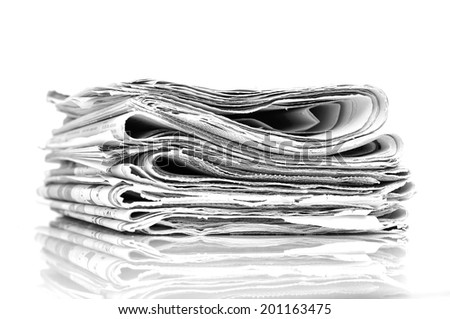 Stacked newspapers - stock photo