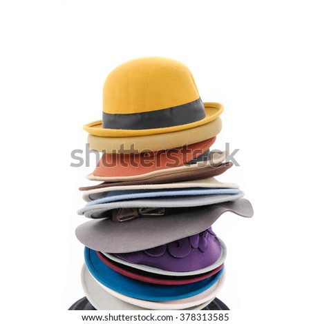 Stacked of fedora hat isolated on white - stock photo
