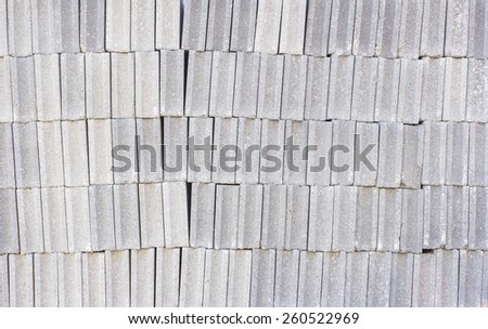 Stacked of gray concrete bricks background - stock photo
