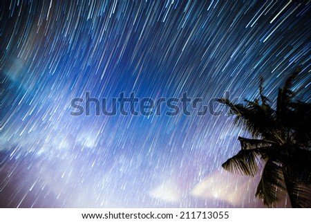 Stacked of images of milky way and stars produced colorful star trails. - stock photo