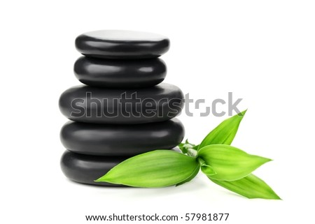 Stacked of stone with bamboo leaf - stock photo
