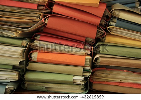 Stacked office files: pile of paperwork in an office - stock photo