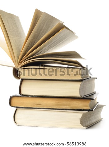 stacked old books are isolated on white - stock photo