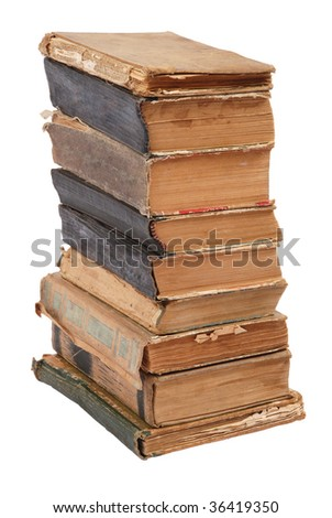Stacked old books of different shape and color. Isolated on white background.