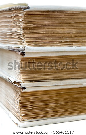 Stacked old books; Pile of books; Written knowledge; Old literature - stock photo