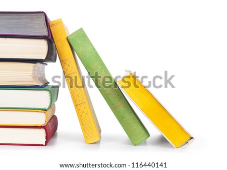 Stacked old colorful books on white background - stock photo