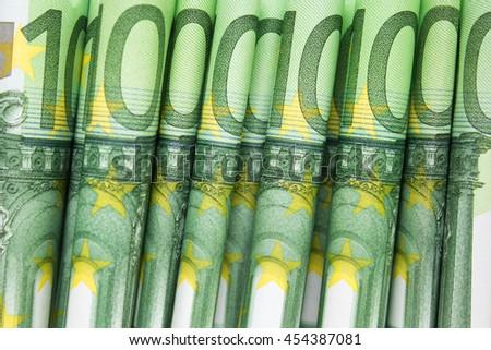 stacked one hundred euro bills - european money - stock photo
