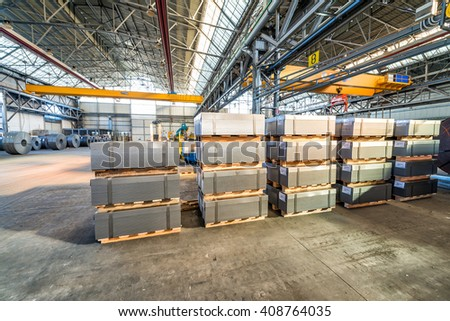 Stacked pallets inside a warehouse. Industrial concept.