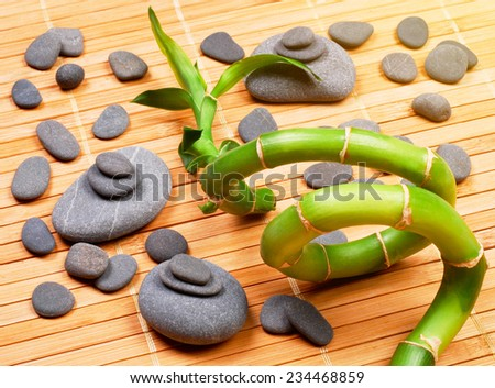 Stacked pebbles and bamboo - stock photo
