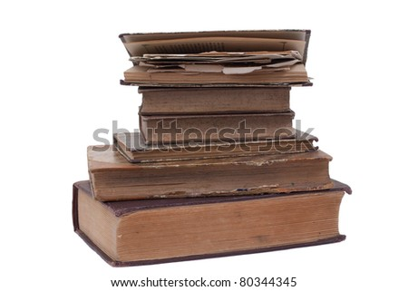 Stacked retro vintage books isolated on white