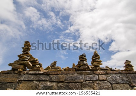 Stacked rocks on top of Mount Mitchell overlooking the Blue Ridge Mountains in North Carolina - stock photo