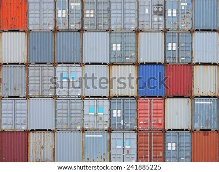 Stacked shipping containers at cargo terminal - stock photo