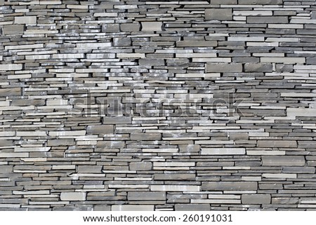 Stacked Slate Stone Wall as horizontal textured background - stock photo