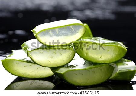 Stacked slice sloe with reflection - stock photo