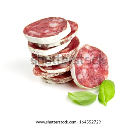 stacked sliced salami isolated on white - stock photo