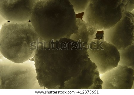 stacked snowball wall illuminated in winter night - stock photo