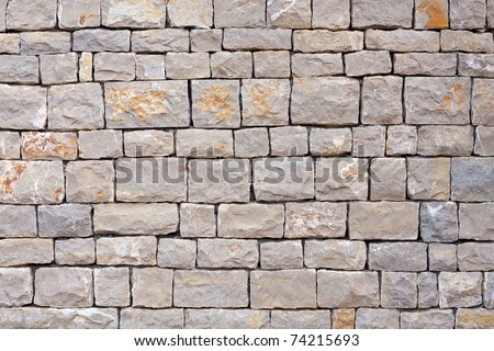 Stacked stones in a wall - stock photo