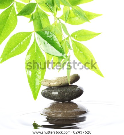 Stacked stones in water - stock photo