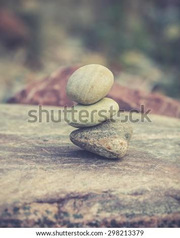 Stacked stones on a natural background. zen bakcground - stock photo
