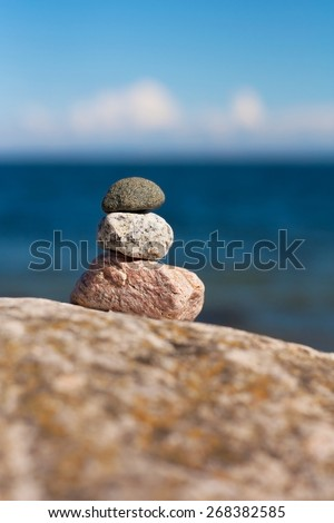 Stacked Stones on the Beach - stock photo