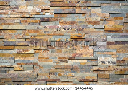 Stacked stones on the wall of a luxury home - stock photo