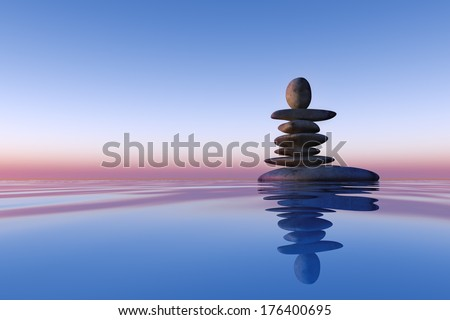 stacked stones on the water - stock photo