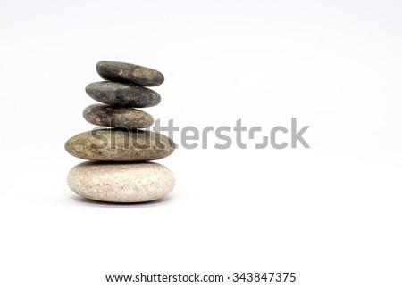 Stacked Stones on White Background. - stock photo