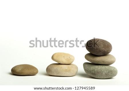 Stacked stones white isolated. Studio shot . - stock photo