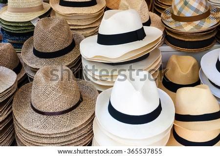 stacked straw hats - stock photo