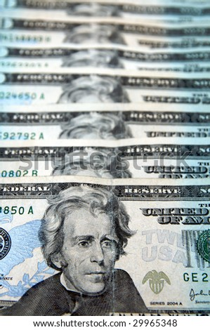 stacked twenty dollar bills - stock photo