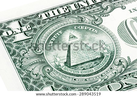 Stacked U.S. one (1) dollar bill in a macro shot, super macro, close up photo. Eye of Providence, all-seeing eye of God, Mason Illuminati Logo, Pyramid, Triangle. Great Seal. - stock photo