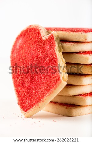 stacked Valentine cookies with a big, bitten heart, isolated on white background, close up, vertical - stock photo