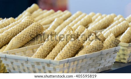 stacked wafer ice cream cones in basket