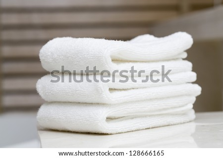 Stacked white spa towels - stock photo