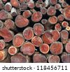 Stacked wood logs background - stock photo
