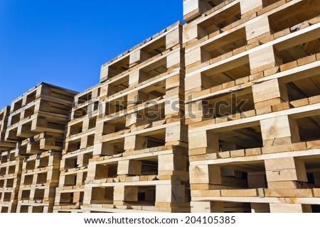 stacked wooden pallets - stock photo