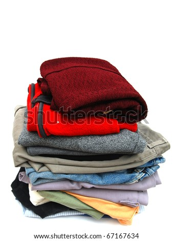 Stacking a laundry load file - stock photo