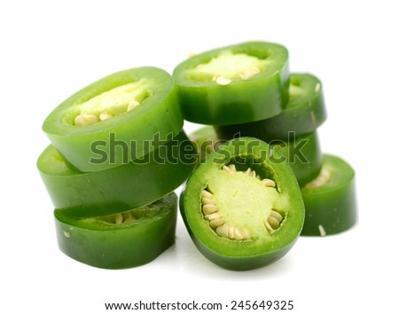 Stacking of hot green chili peppers (jalapeno) - stock photo