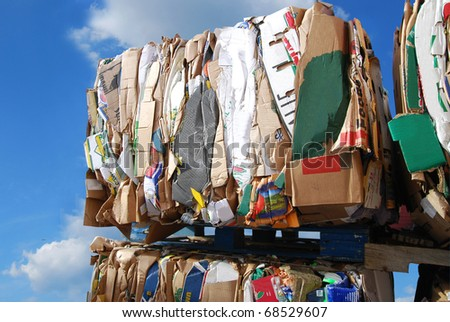 Stacking on waste cardboard bundles - stock photo